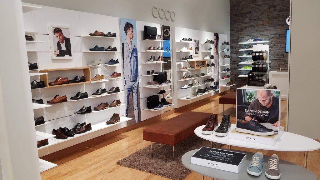 Sleek and sturdy retail display shelves for one of ecco's Tanger Outlet retail locations by Dras Cases.
