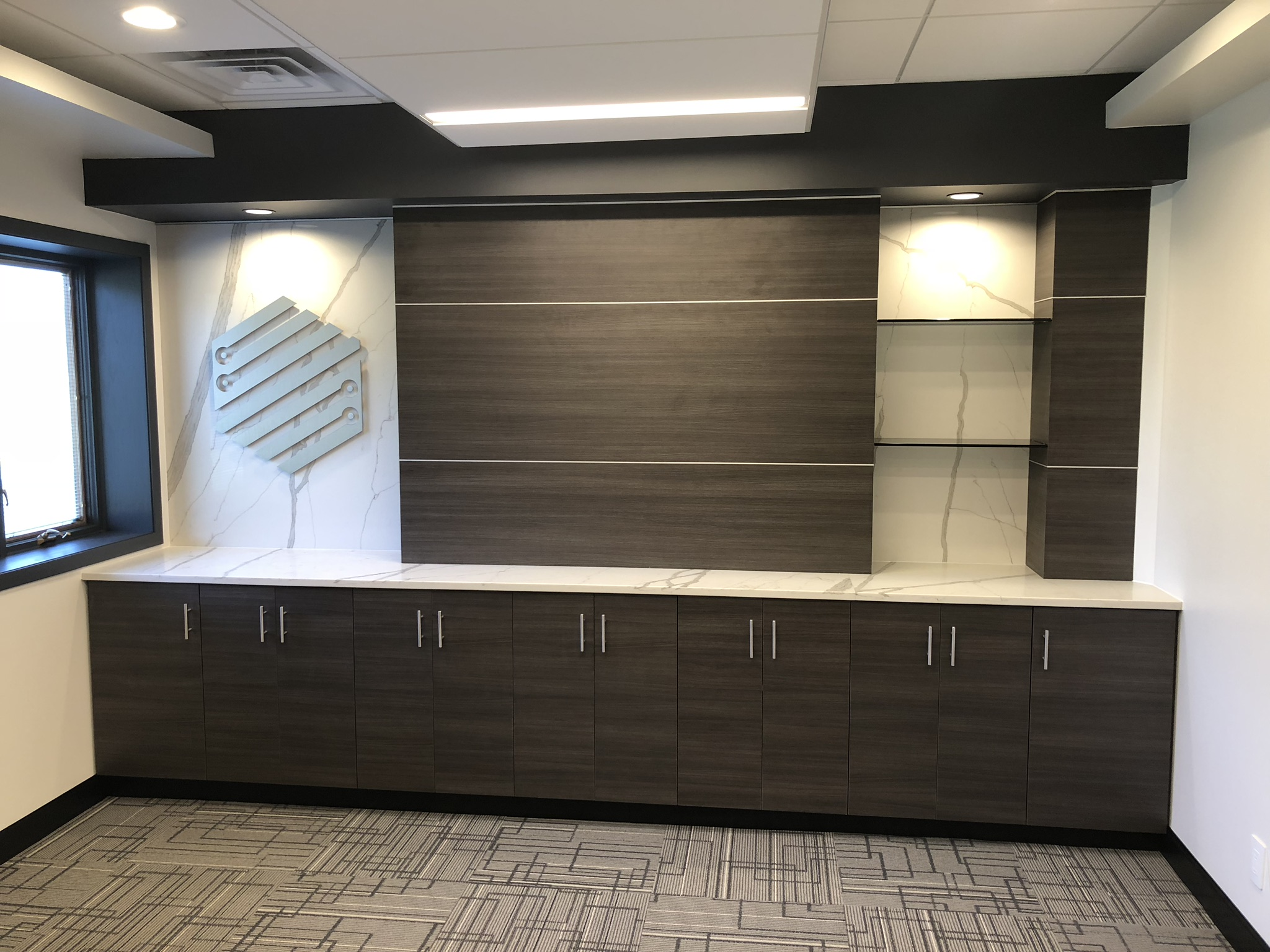 Dras Cases designed this beautiful cabinetry at El Microcircuit in Mankato, MN
